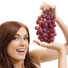 Cheerful woman with grape, over white