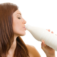 Beautiful woman drinking milk, over white