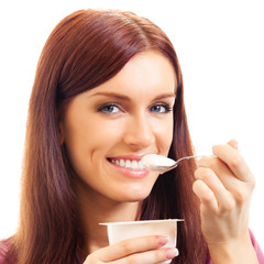 Cheerful woman eating yoghurt, over white