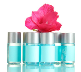 cosmetic bottles and flower, isolated on white.