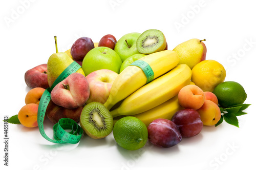 Different sorts of fruit and spicy herbs isolated on white .