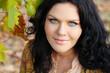 Closeup of brunette woman with blue eyes, outdoors portrait. Per