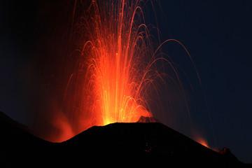 Fire at night. Volcano erupting