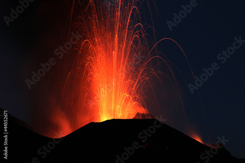 Fire at night. Volcano erupting