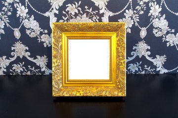 Gold Vintage picture frame on old wood background