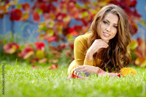 beautiful girl with book in the autumn park
