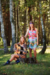 Hippie girls with guitar sitting on the stump