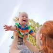 baby with Down syndrome is happy and flying up - 44555463