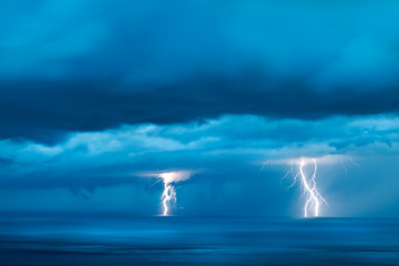 Storm over the sea with lightning