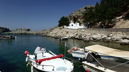 Fishing boats and church in St Paul's bay, Lindos, Rhodes