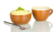 Mashed potato with parsley in the bowl and cup with milk