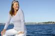Beautiful happy mature woman water background