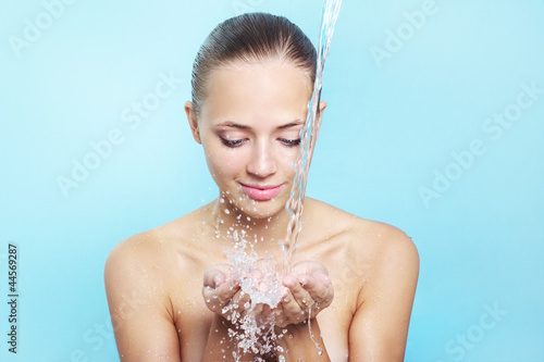 Beautiful girl and stream of water