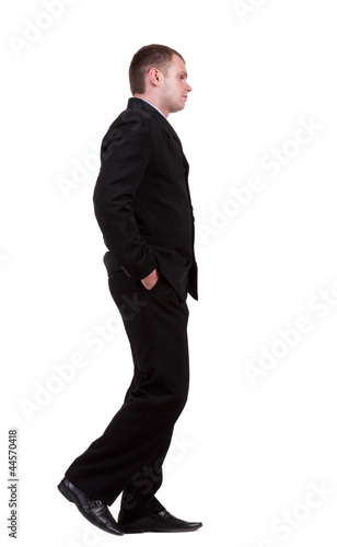back view of walking sad businessman