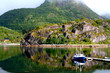 Lofoten, mirror lake with boat