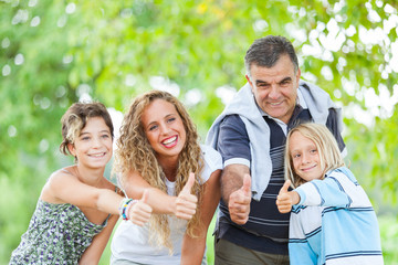 Happy Family Outdoor with Thumbs Up
