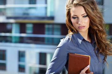Manager  business woman on the background of the modern office