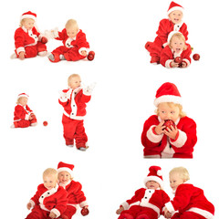 two fanny kids in santa clauss costumes isolated on white