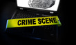laptop fingerprint with crime scene tape across it
