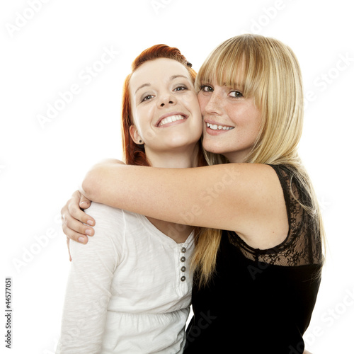 young beautiful red and blond haired girls hugs