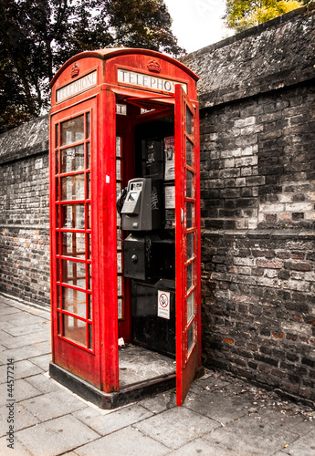 Old English Telephone box on a side street of London UK England - 44577214