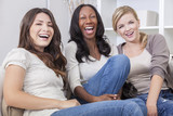 Interracial Group of Three Beautiful Women Friends Laughing