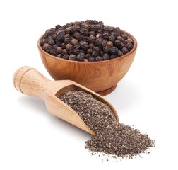 milled black pepper isolated on white