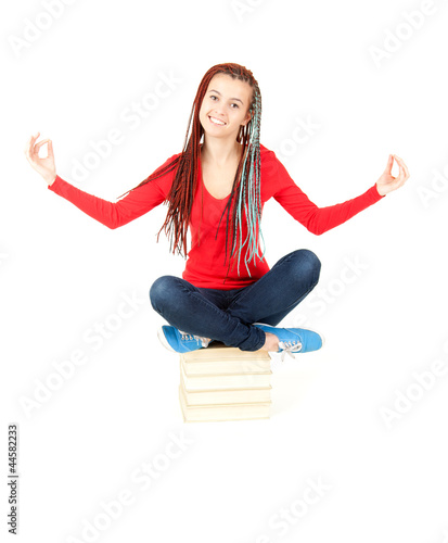 meditating young student girl with african hairdo and books