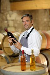 Wine waiter standing in wine cellar