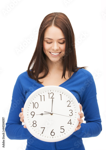 woman holding big clock