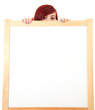 teenage girl hiding behind blank placard