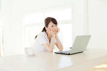 Beautiful business woman using a laptop computer. Portrait of as