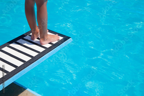 Fotobehang Water Motorsp. Boy, thrampoline and swimming pool