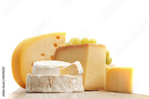 cheese on a wooden table - 44590287