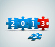 New Year 2013 card made from blue and red puzzle pieces