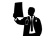 A silhouette of a medical doctor examining CT scan