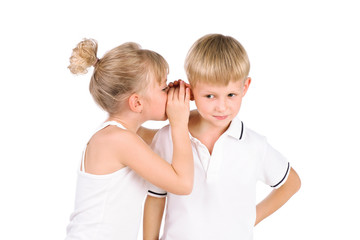 5-7 years old girl tells a secret to the boyfriend  isolated ove