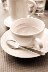 wonderful white cup of hot coffee on table
