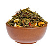 Dry fruit green tea in a clay cup