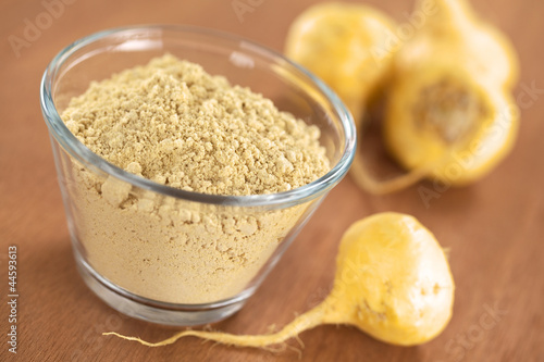 canvas print picture Maca powder (flour) with maca roots or Peruvian ginseng