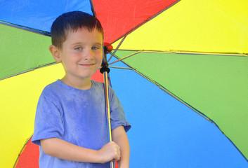 Boy Holding Rainbow Umbrella