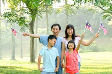 malaysian family with malaysian flags