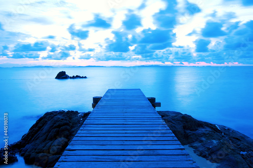 Wooden pier at the beach in the morning light