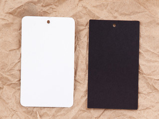white and black price tags isolated on cardboard