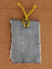 jeans price tag or address label isolated on cardboard