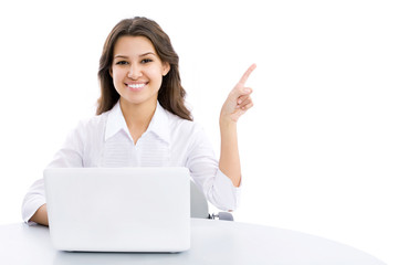 Young business woman pointing at corner