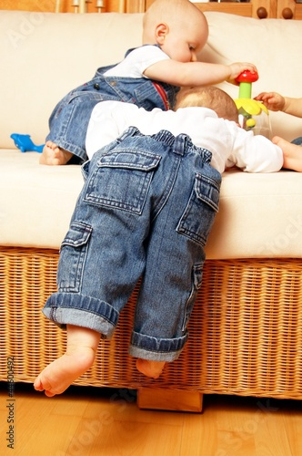 child climbing onto sofa