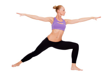 Woman doing warrior yoga pose