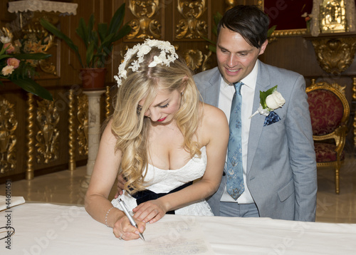 Bride and Groom signing the register in church
