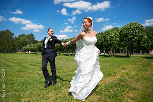Happy groom and happy bride on wedding walk
